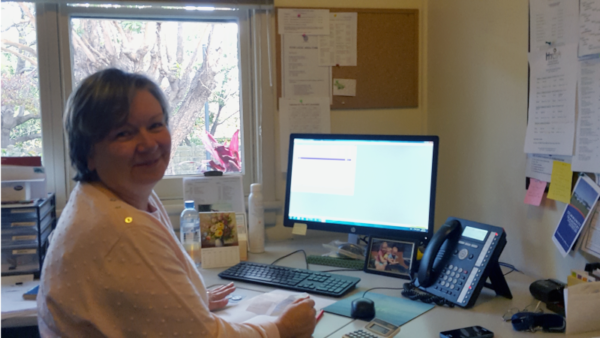 Photo of a lady behind a desk