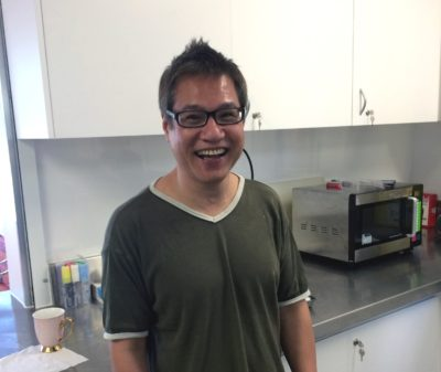 Young man smiling in a kitchen