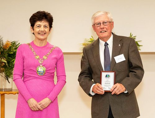 Sydney Community Services chair John Devine honoured